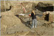 Woman standing in an archeology dig site