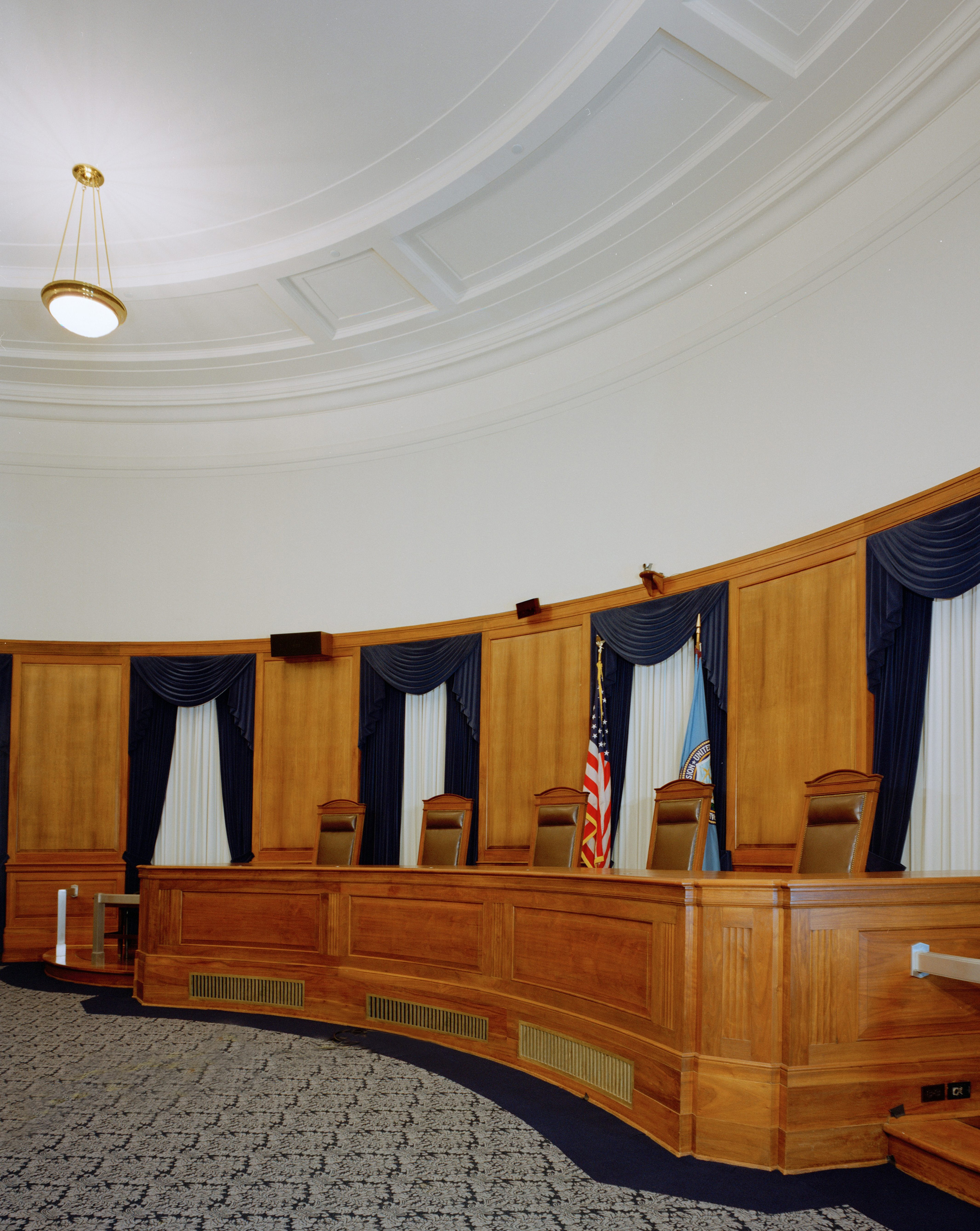 Hearing room inside the FTC. Located in the apex of the building, the room mirrors the exterior's rounded shape.