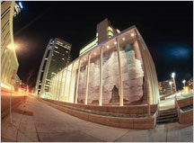 Exterior photo of Alfred A. Arraj United States Courthouse at night.