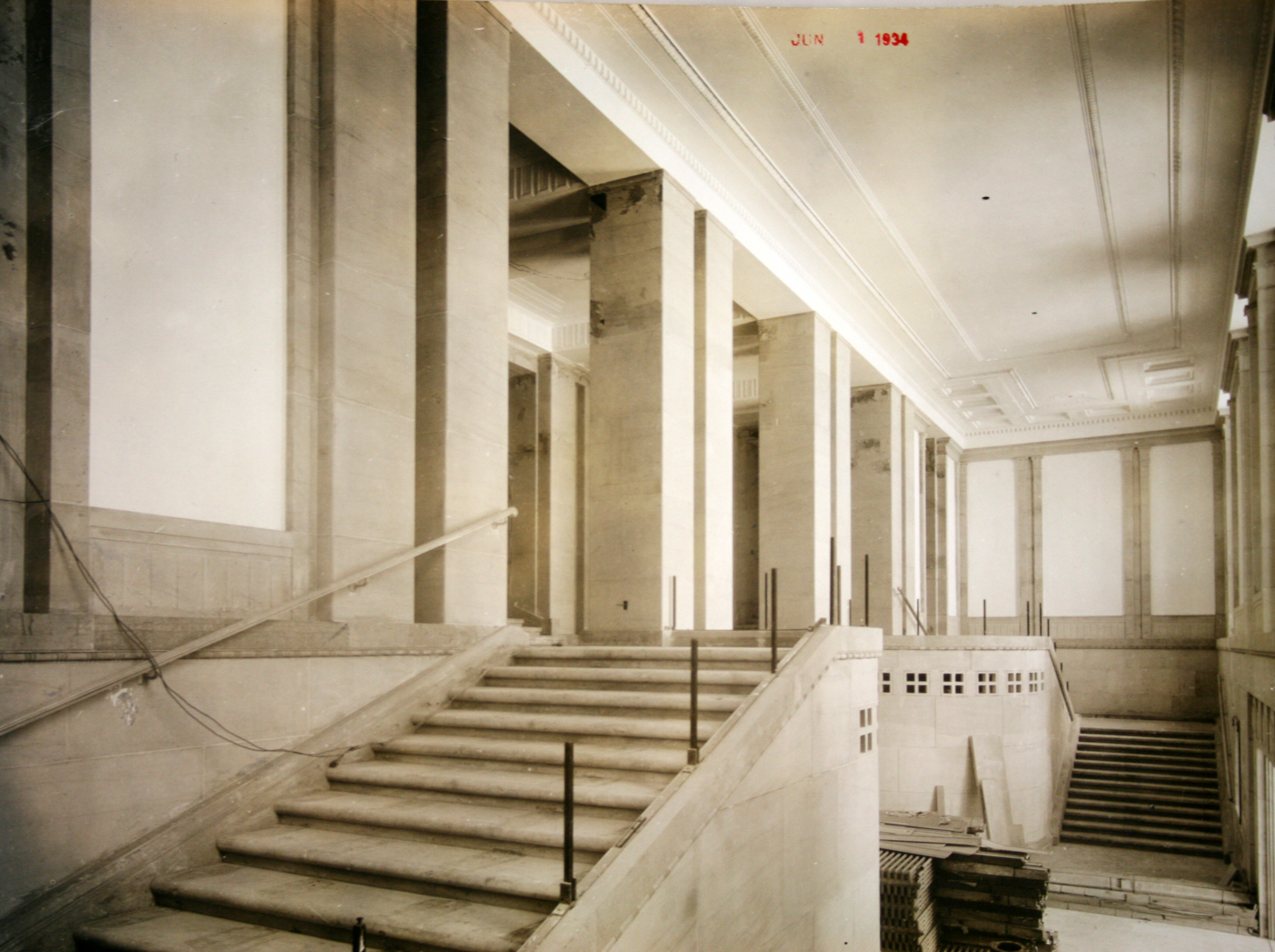 The monumental staircase between the first and second floors is prepared for the installation of a series of murals depicting important individuals in the history of law, c. 1936.