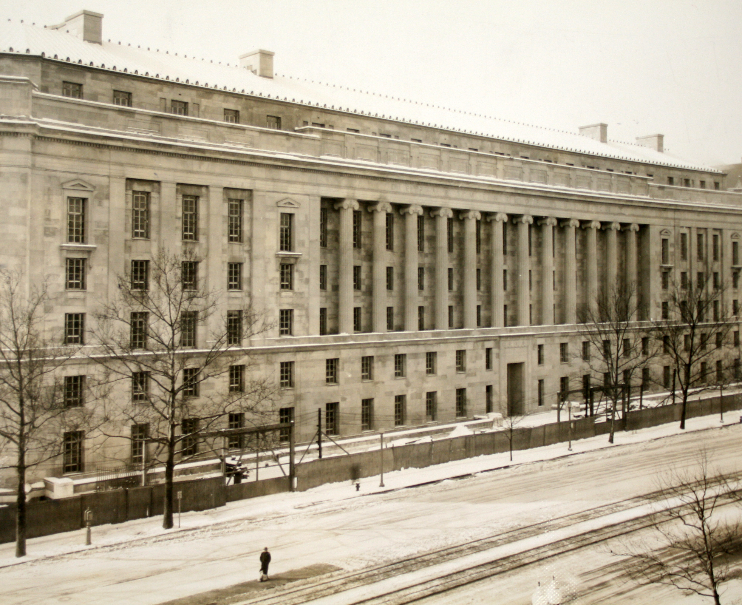 Historic photograph of the Constitution Avenue facade of the Justice building.
