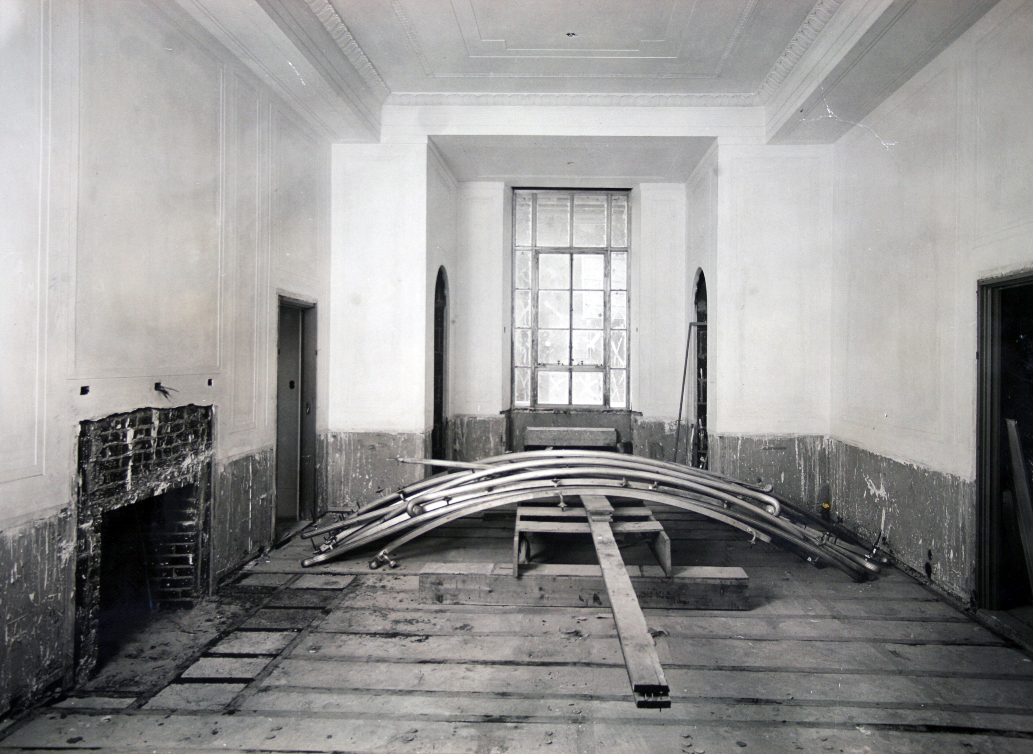 Interior view of the Justice building under construction. The office shown is awaiting installation of wood flooring and the fireplace mantel.