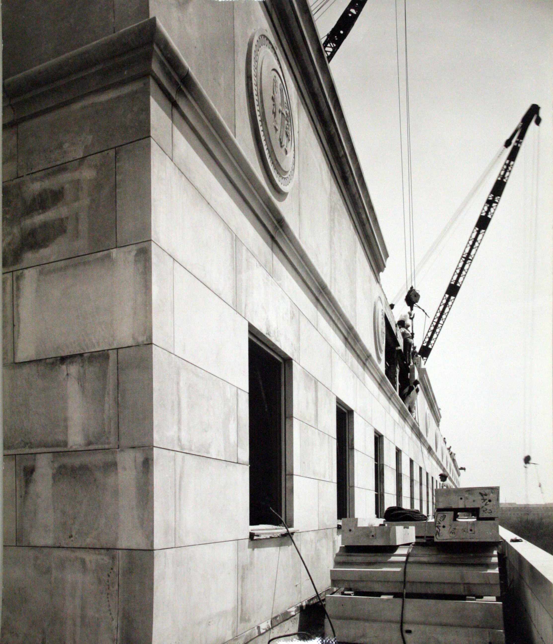 Construction photograph, building cornice, 1936.