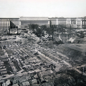 Construction of the foundation of the Justice building. The Commerce building is visible in the background, c. 1931.
