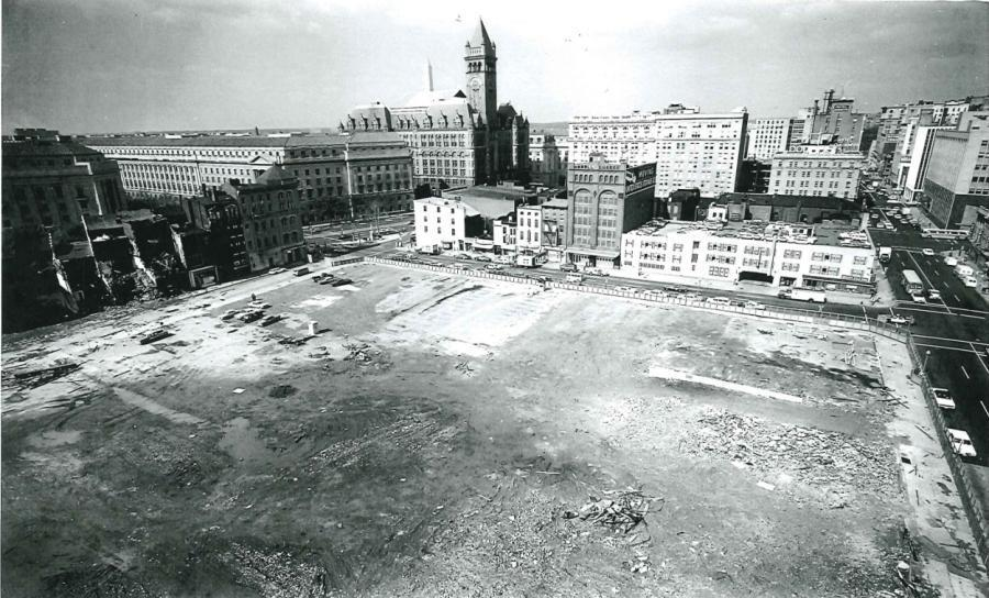 FBI building, Southwest View of the Cleared Site with the Old Post Office Building Tower in the Background, c. 1967.
