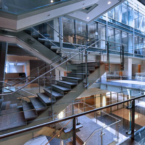 The atrium features a large staircase that provides a central thoroughfare for circulation throughout the building.