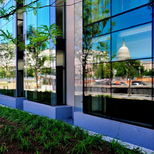 The new glass curtain wall reflects scenes from around the building, showing off its premiere location near the U.S. Capitol.