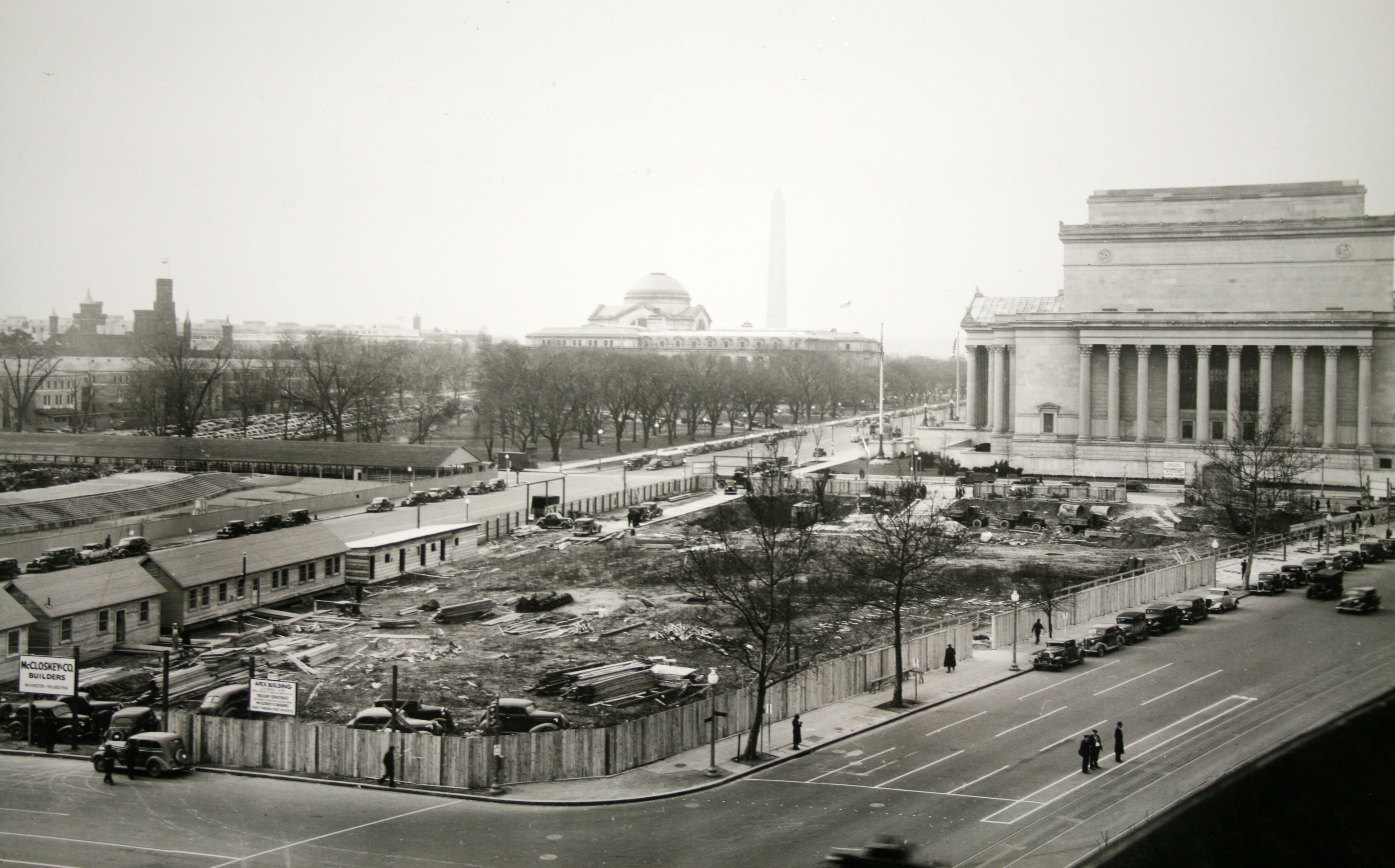 Very early stages of construction on the FTC building. The National Archives is visible behind the site, as well as the Washington Monument and Smithsonian Natural History Museum in the distance.