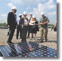 GSA Administrator Martha Johnson, and others, visit rooftop where solar panels were installed