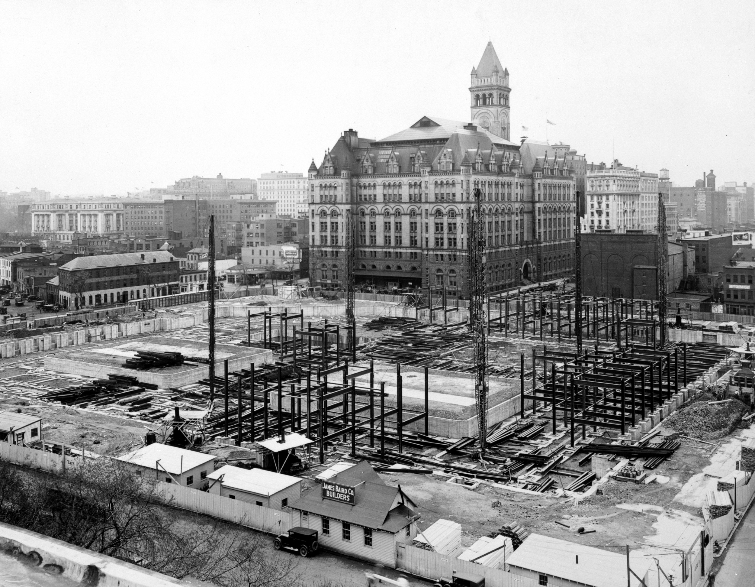 Framing of the IRS building begins. The Old Post Office is visible in the background.