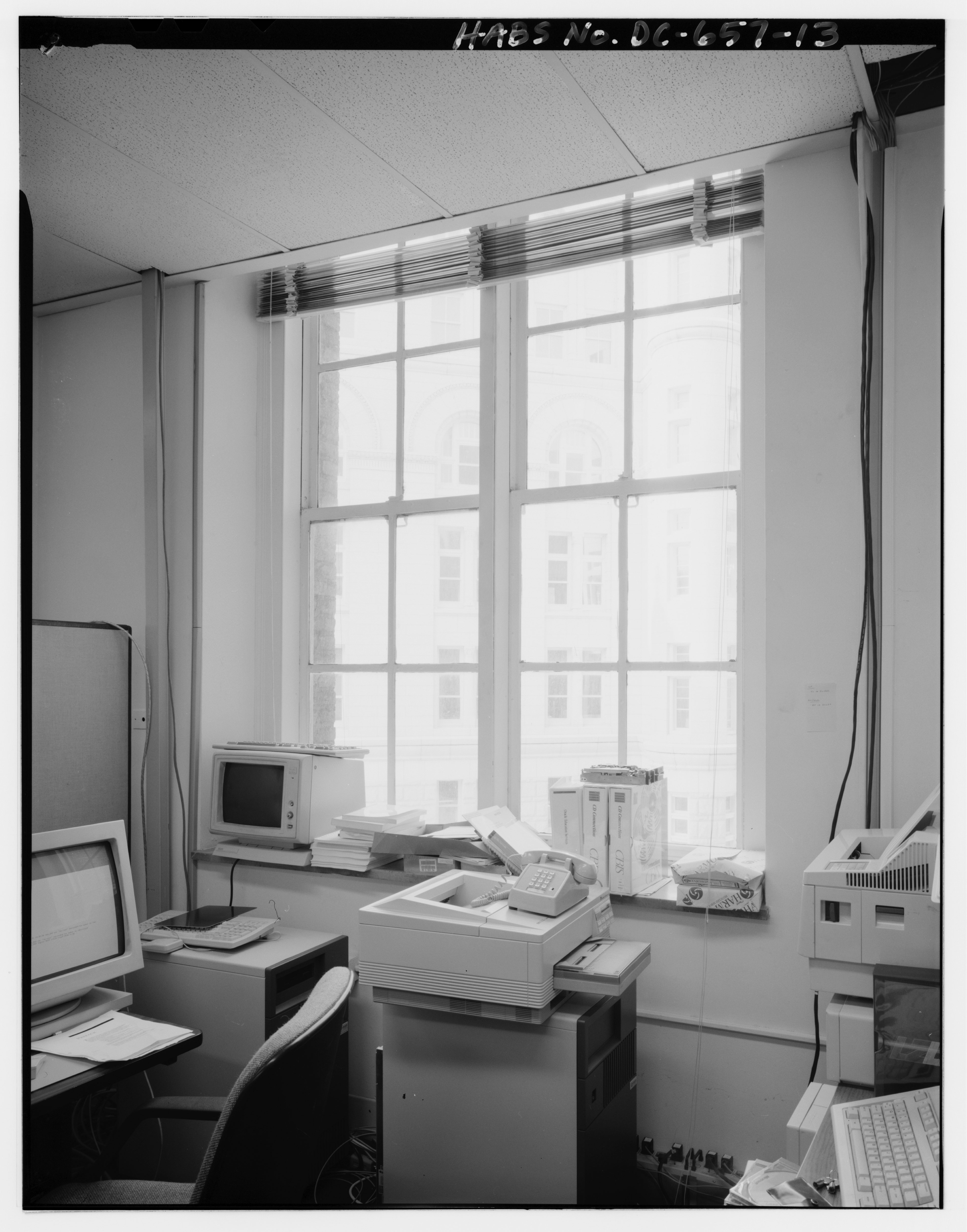 Late twentieth century photograph of an office space inside the IRS building.