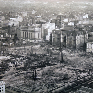 Aerial of the Federal Triangle, including the Old Post Office and IRS building, which stand across the street from the foundations of the New Post Office Building (Clinton building).