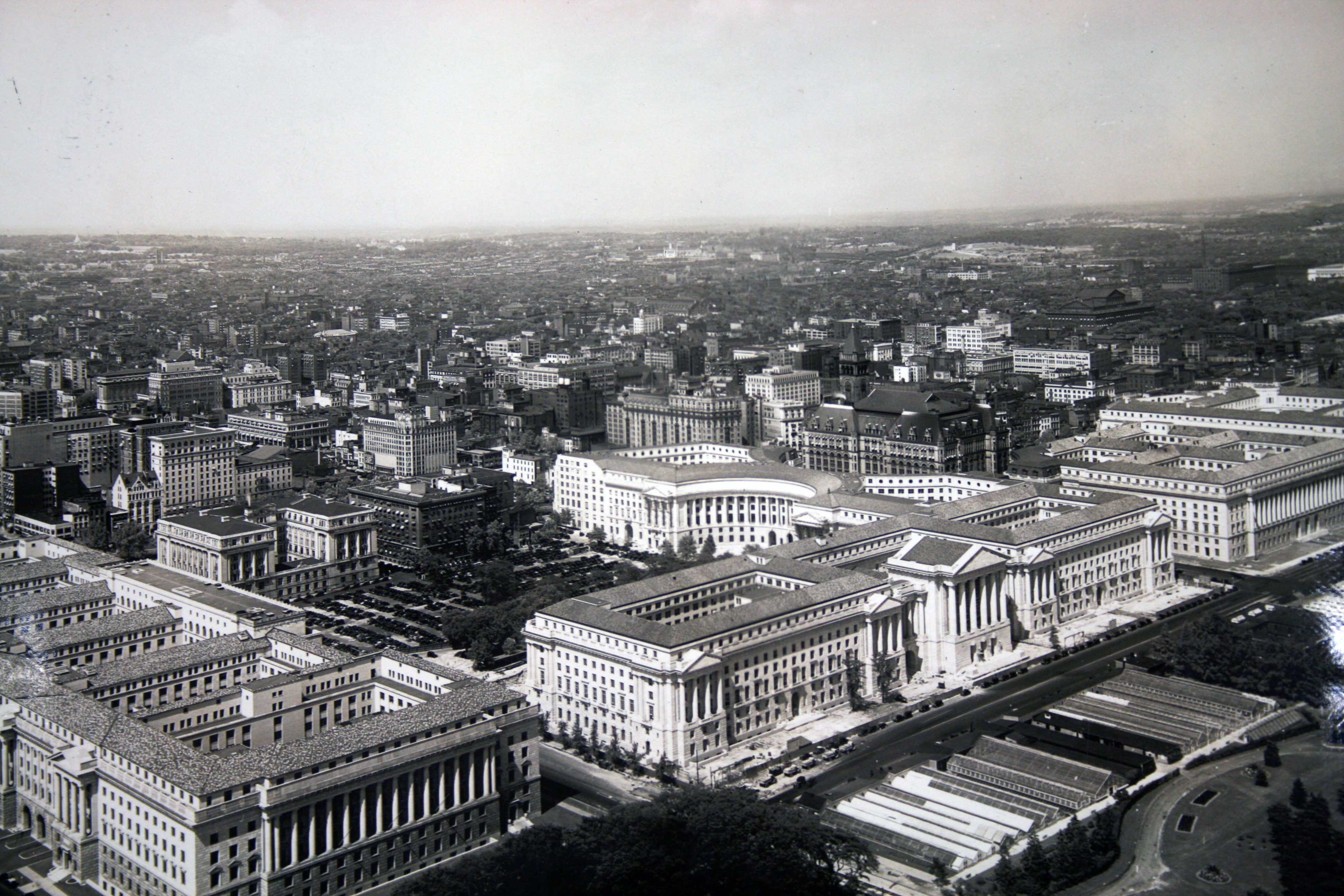 Illuminated by the Commerce building, up to 2,000 cars parked on the site of the Reagan building prior to construction.