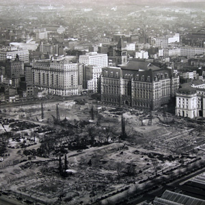 Aerial view towards the Old Post Office, including construction of the Clinton building and parking lot, which would become the home of the Reagan building.