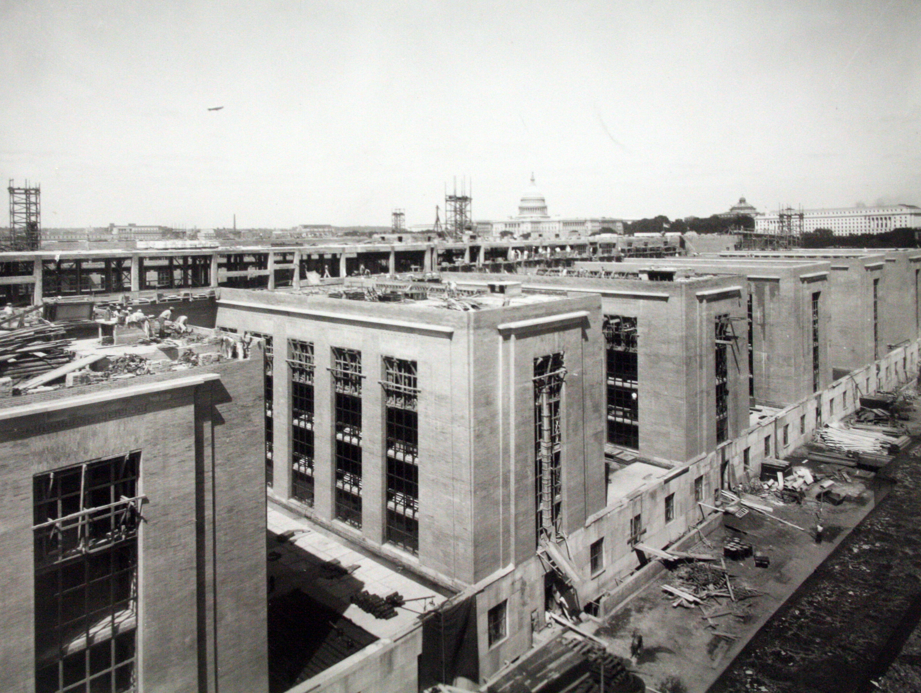Construction of a long central corridor from which six short, narrow wings project on both the north and south sides, c. 1939.