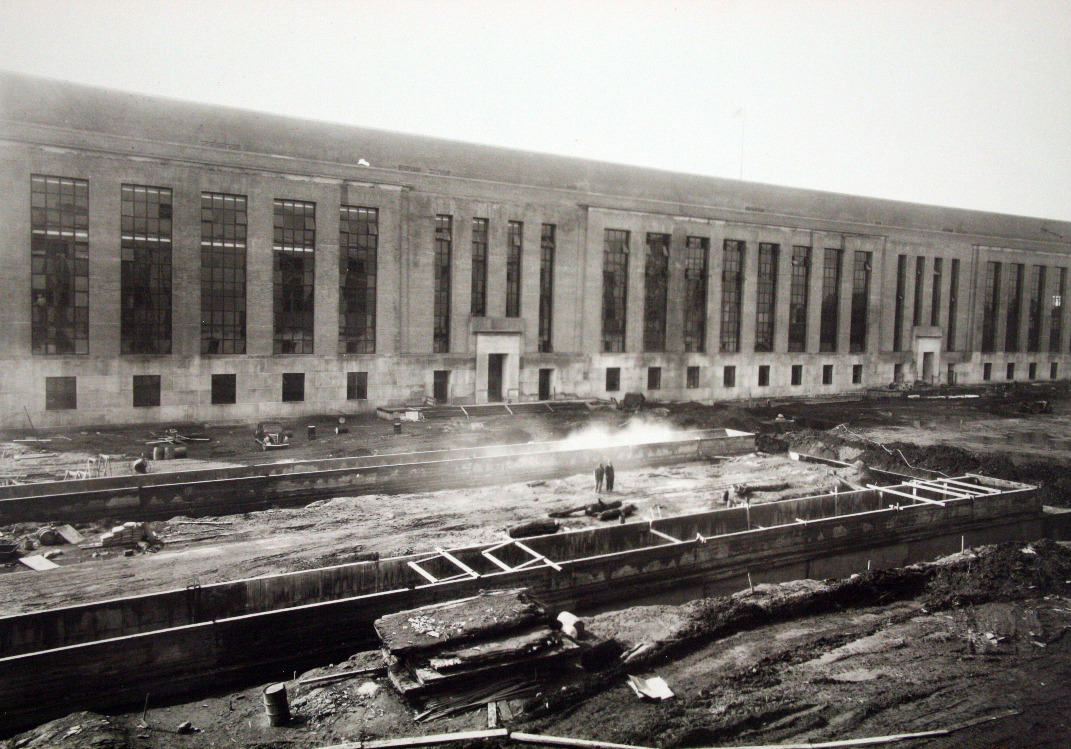 Installation of a garage and surface parking spaces along the C Street facade, c. 1939.