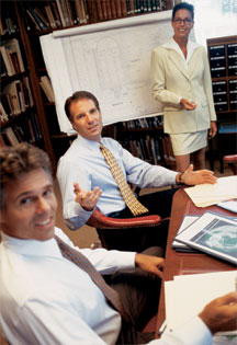 Photos of three working people around desk