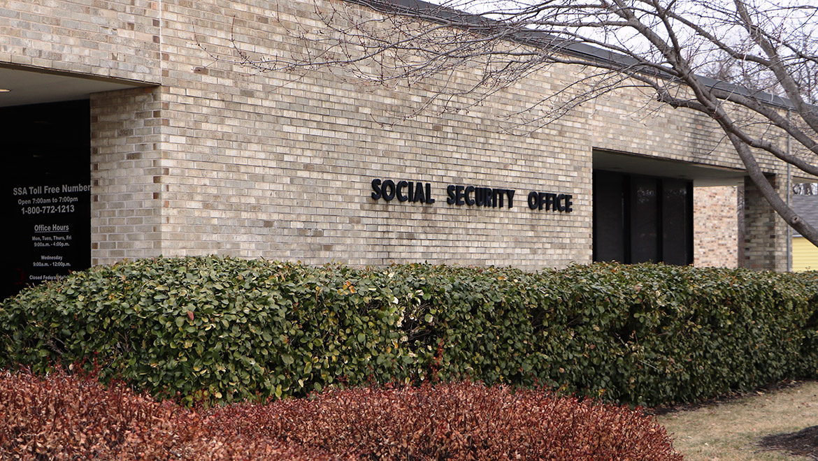 Facade of a yellow brick building marked with Social Security Office on the exterior, in Kansas City, KS