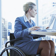 Woman in Wheelchair working in an office