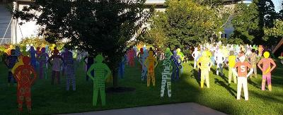 Multi-colored life-size silhouette sculptures of 200 youth