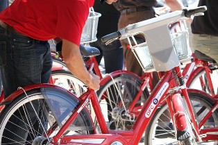 Image of a man bending over one of the Bcycle bikes