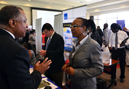 Dhana Moore (right) discusses IT opportunities with attendee