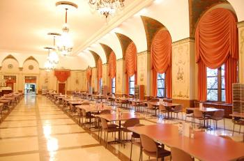 Interior shot of grand cafeteria with recently restored chandeliers and window detailing