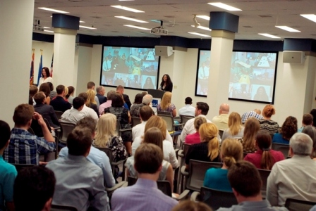 Denise Roth addressing employees at a townhall meeting