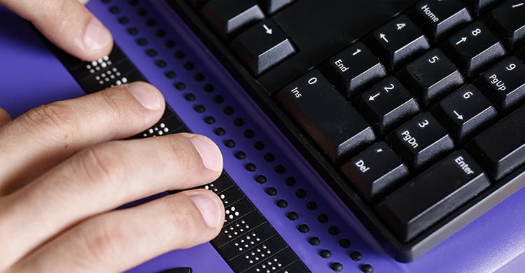 Image of a person's hands while they read braille