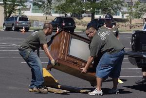 People recycle electronics at the Denver Federal Center Recycling Day