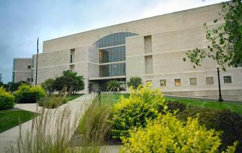 Exterior long shot of Hammond U.S. Courthouse with sustainable, native landscaping in foreground