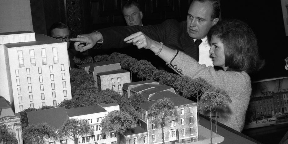 Photo. First Lady Jacqueline Kennedy views a scale model of the historic preservation and redevelopment plans for Lafayette Square, Washington, DC, while architect of the Lafayette Square redevelopment, John Carl Warnecke, points to an area of the model