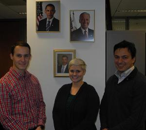 GSA Impact Fellows standing before presidential portrait wall in Chicago office