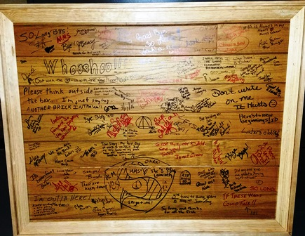 Image of framed office wall with employee handwritten messages