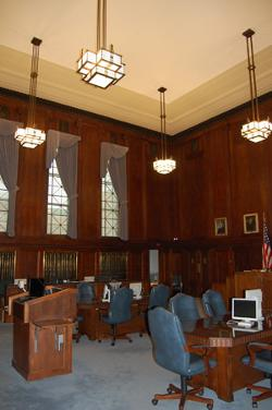 Interior courtroom shot featuring ceiling, lighting, and woodwork