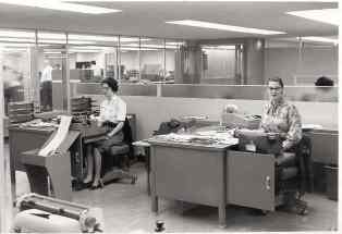 Historic image of two ladies working in the office