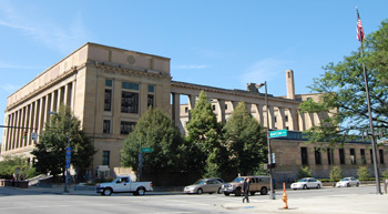 Long shot of an exterior street-level view of the Kinneary U.S. Courthouse