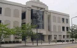 Exterior street-level view of the front entrance of the Lambros U.S. Courthouse and Federal Building.