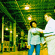 Man and woman in warehouse setting