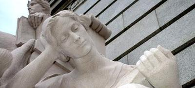Sculpture of a woman reading a book at the US Courthouse, Providence, RI