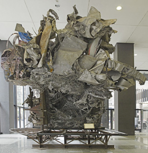 Photo of the metal sculpture Town Ho's Story by Frank Stella in the building's lobby