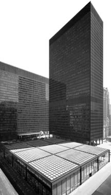 Aerial black and white rendered photo of the Chicago Federal Plaza showing the Dirksen Courthouse, Kluczynski Federal Building, and Loop Post Office