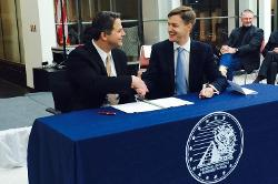 NNSA Site Manager Mark Holecek and GSA Regional Administrator Jason Klumb sign transfer agreement.