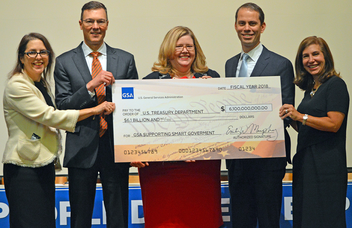 Administrator Murphy presented GSA senior leaders with a ceremonial check