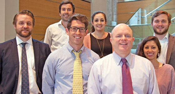 Seven smiling people from the GSA Office of Evidence and Analysis