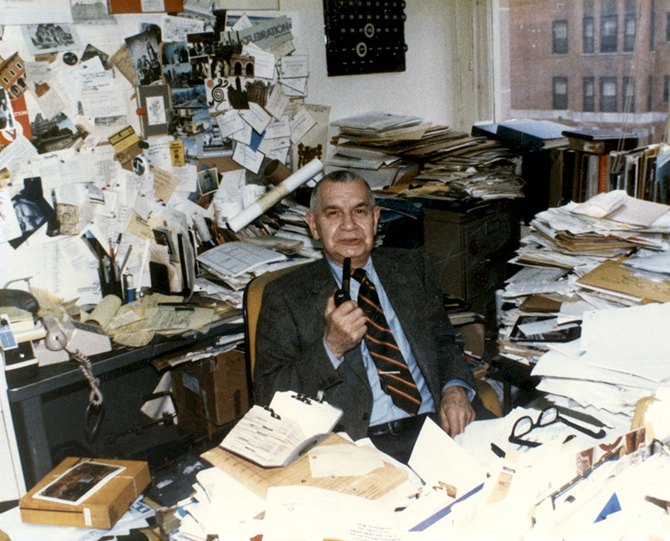 Karel Yasko sitting at his desk in his office on the 3rd floor at GSA Headquarters
