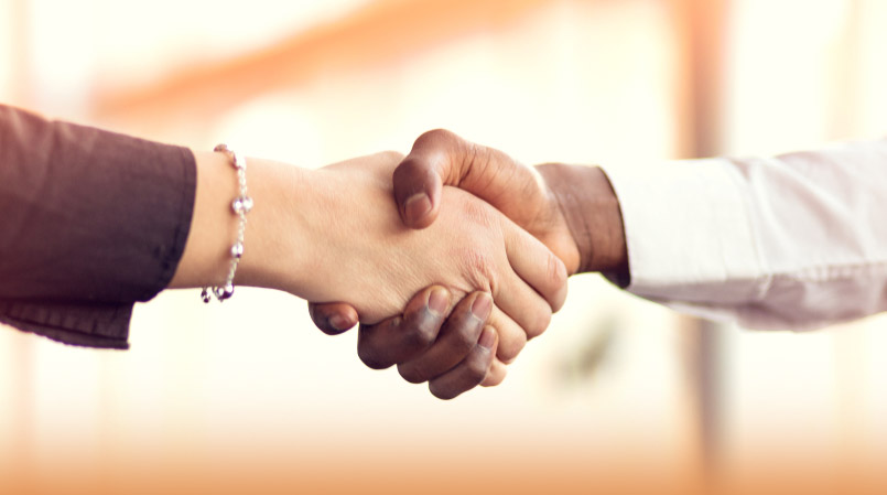 Closeup of two businesspeople shaking hands
