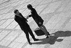 Photo of a man and a woman shaking hands