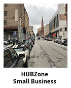 HUBZone Small Business slide, streetview of an urban environment with buildings and cars