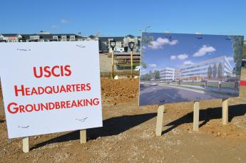 CIS Groundbreaking signs stuck in ground at site